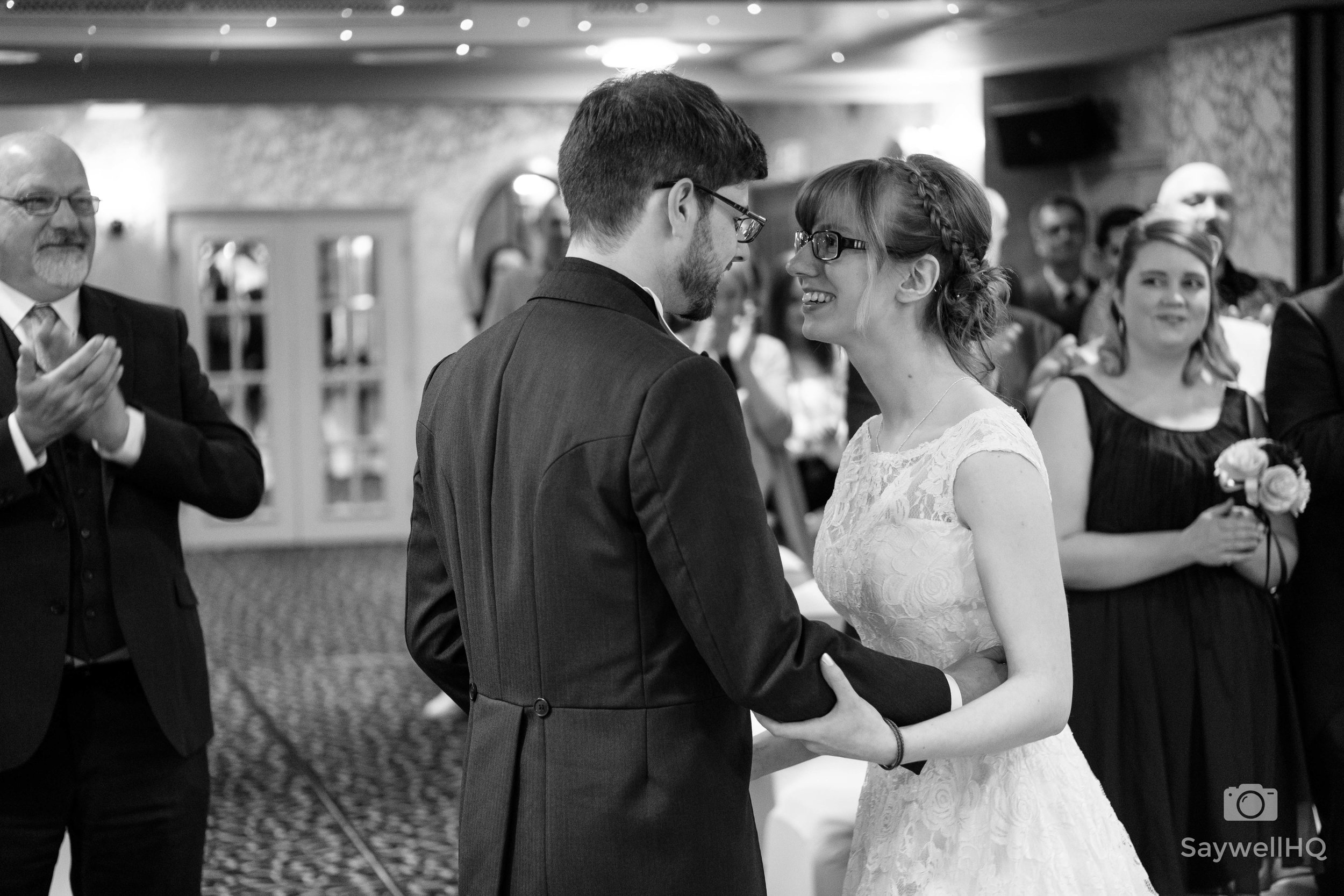 wedding at the Belmont Hotel in Leicester - bride + groom looking happy during the wedding ceremony