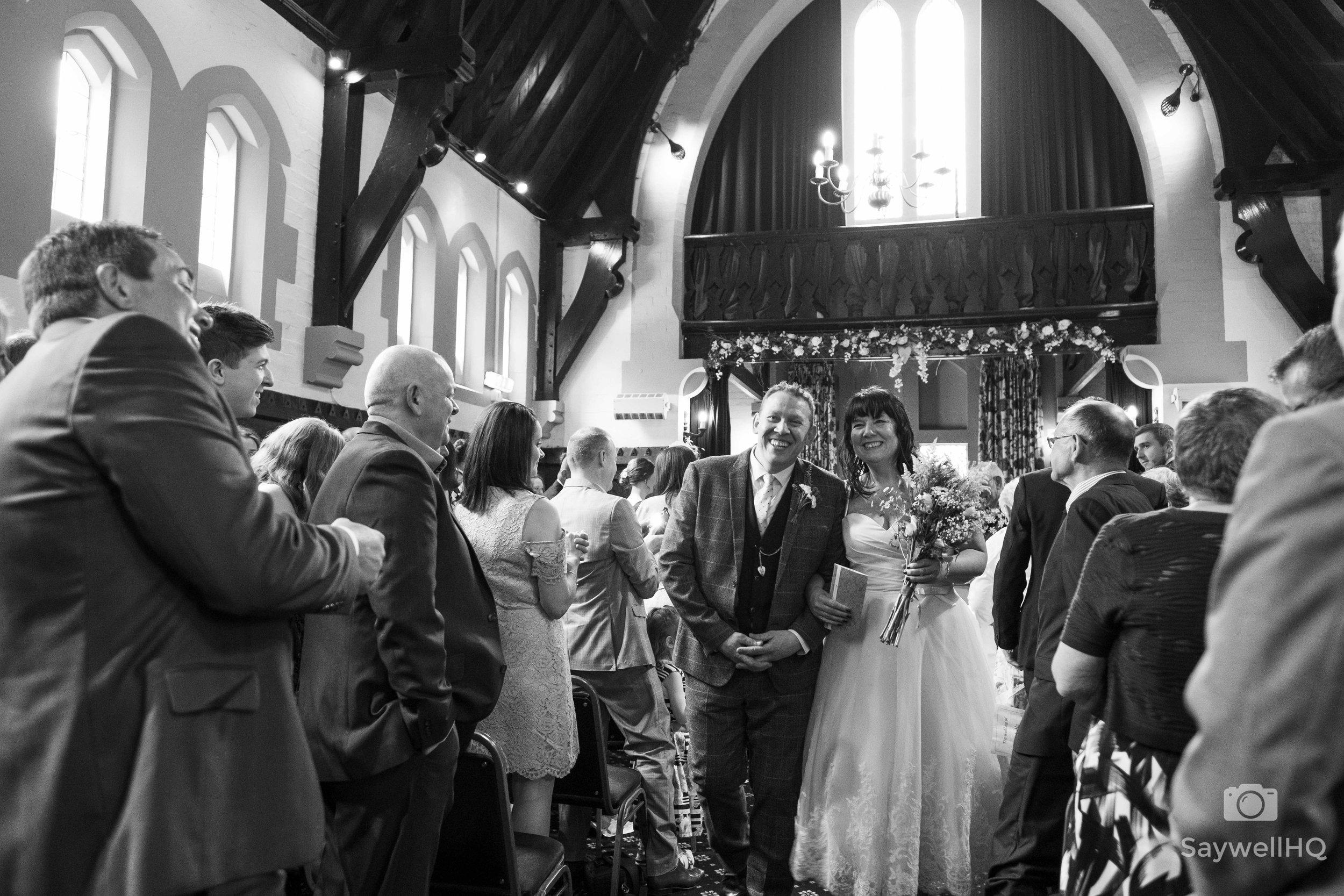 Wedding Photography at the Bestwood Lodge Hotel + bride + groom walking down the aisle