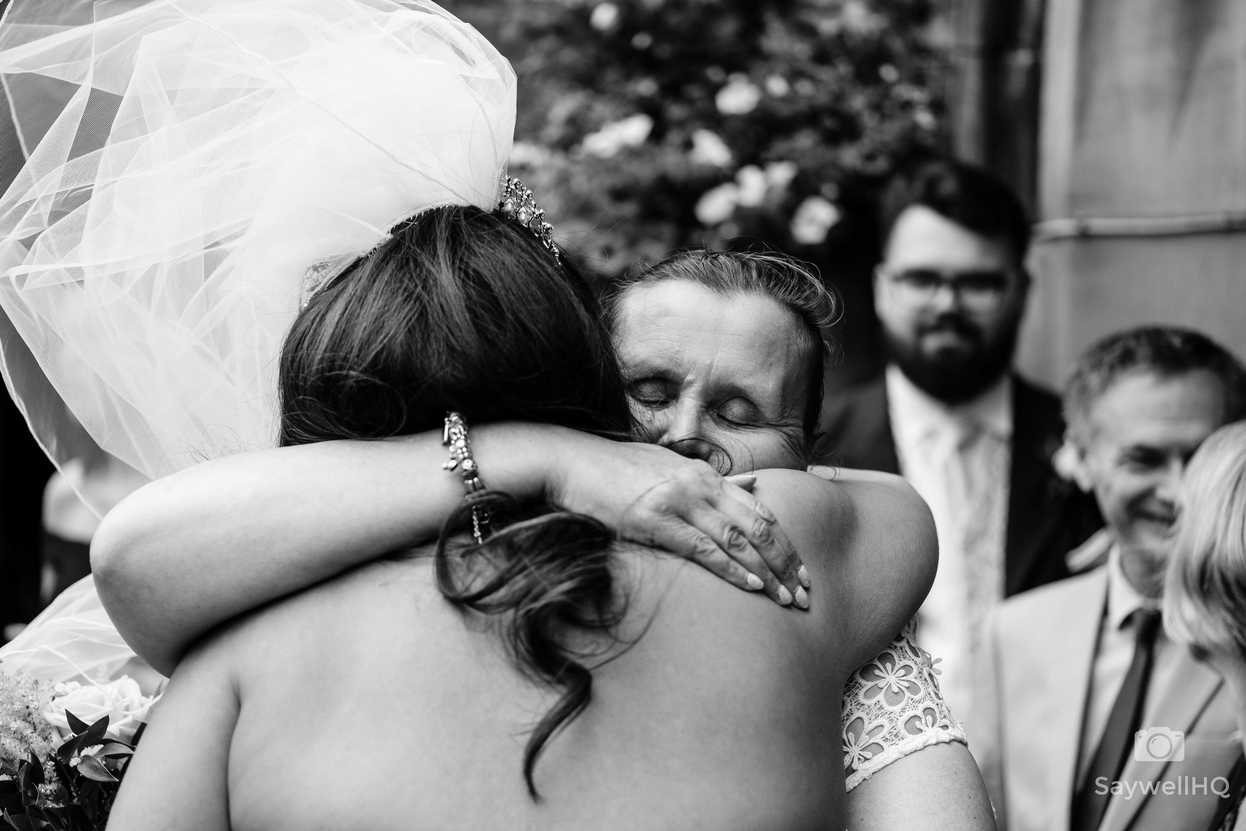 wedding hugs + emotional hugs at weddings