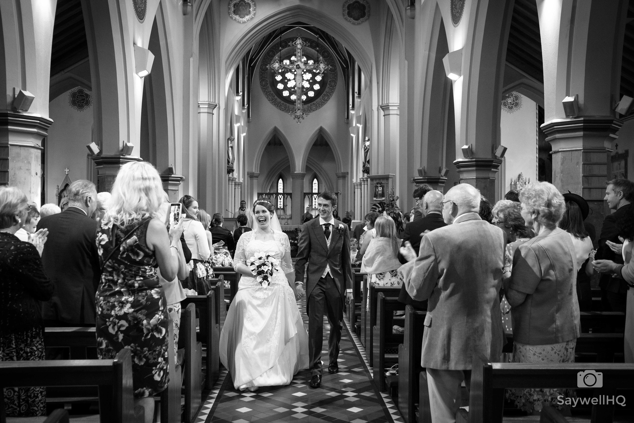 Wedding Photography at St. Barnabas Cathedral in Nottingham + bride + groom walking down the aisle