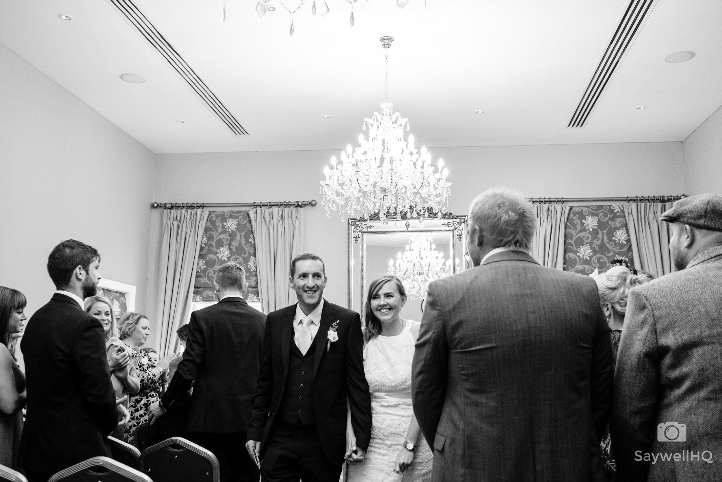 Wedding photography at Bridgford Hall - bride and groom leave the wedding room at bridgford hall in west bridgford