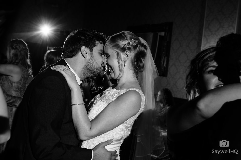 The best Wedding photographer Nottingham - bride and groom holding each other during the first dance at alfreton hall
