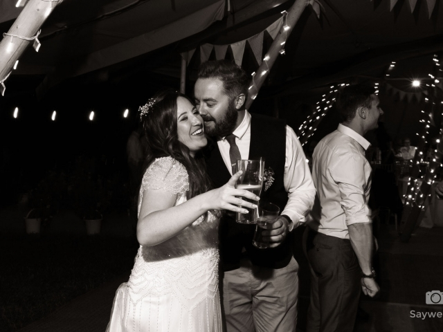 humanist wedding photography at mapperley farm + happy bride and groom kissing during the wedding disco
