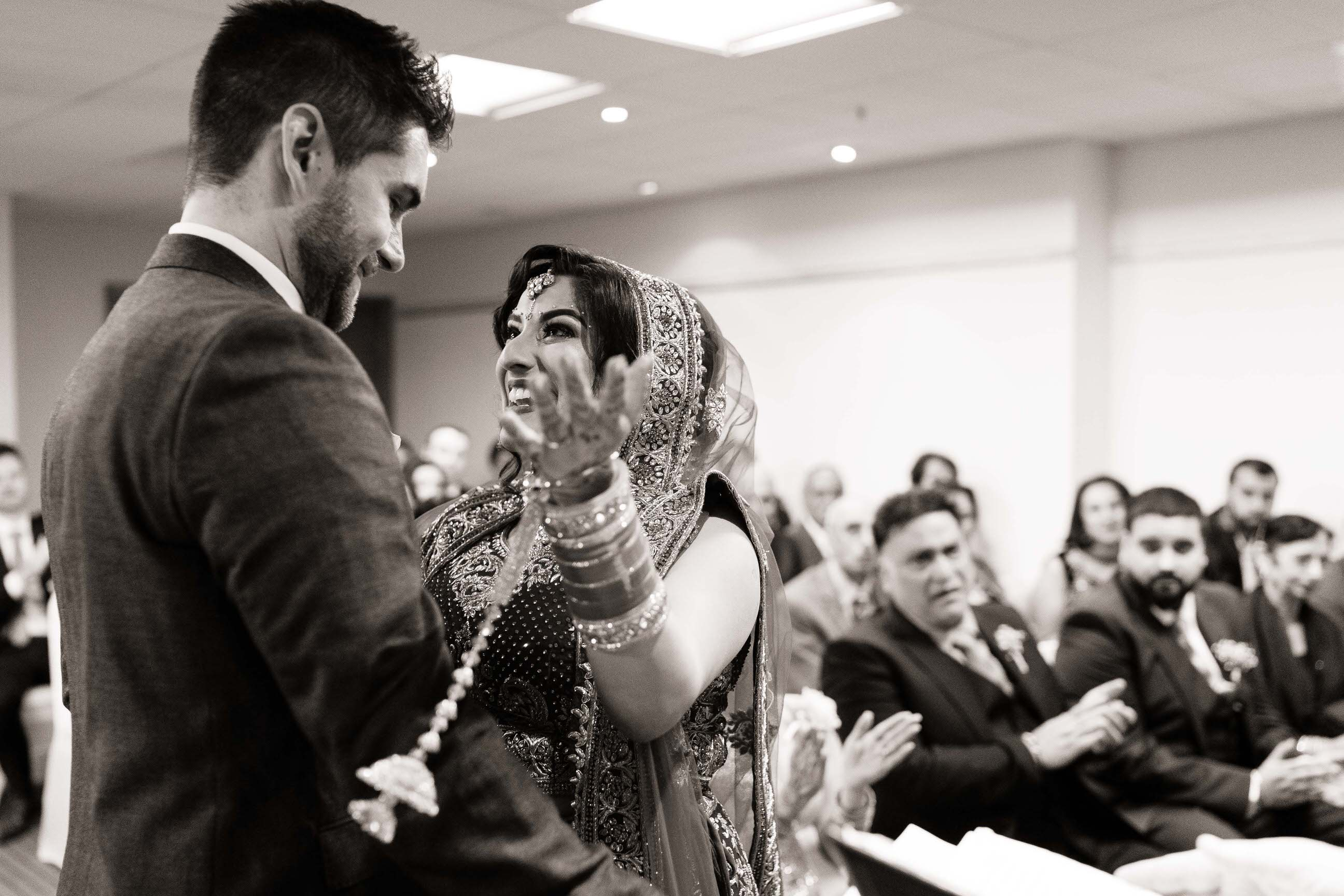 Best Wedding photographer Nottingham - bride looking happy at the news that they are now married