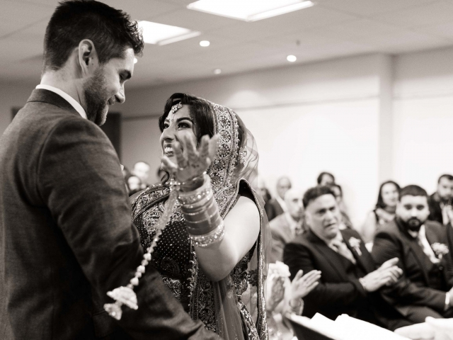 Wedding Photography at The Crowne Plaza Nottingham Bride and groom celebrate after the wedding ceremony
