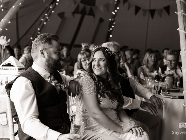 humanist wedding photography at mapperley farm + bride and groom looking at each other during the wedding speeches