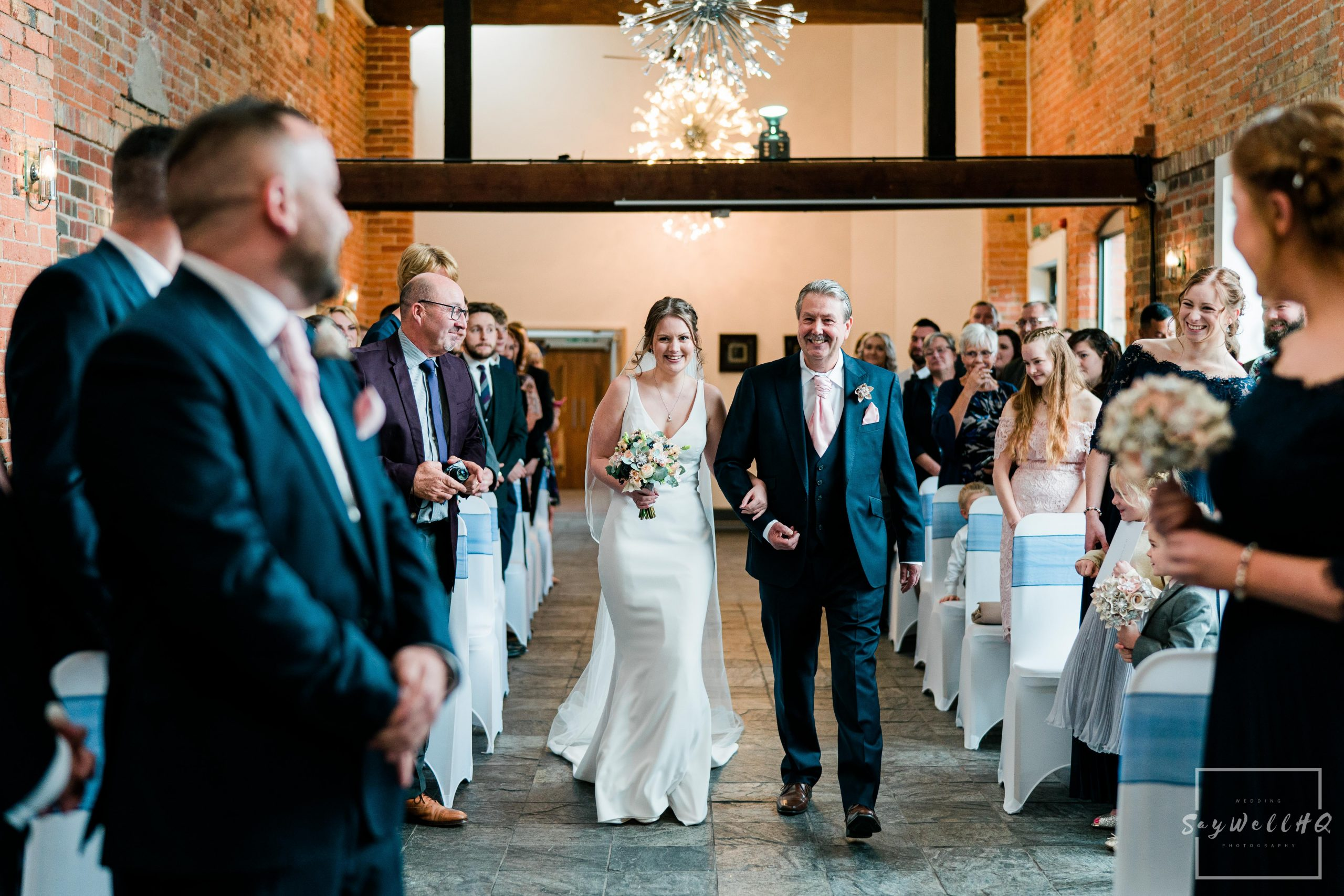 Derby Wedding Photographer -bride and her dad walking down the aisle.