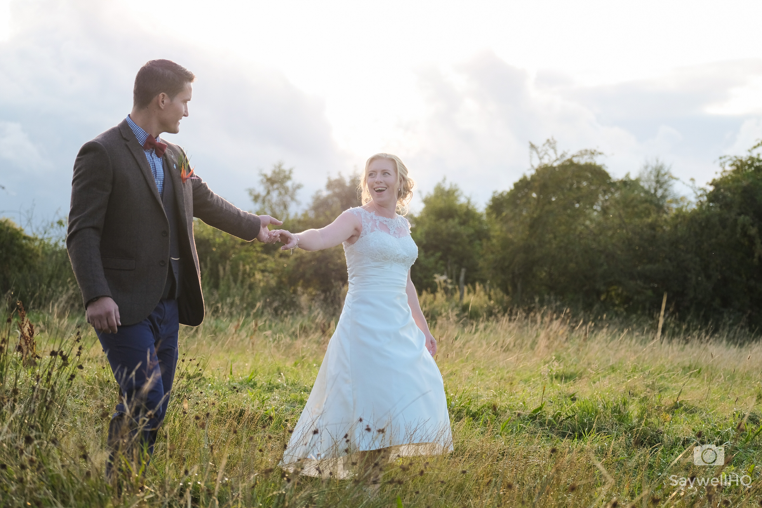 Humanist Wedding Photography at Sycamore Farm Barns in Derbyshire - Bride and groom walking