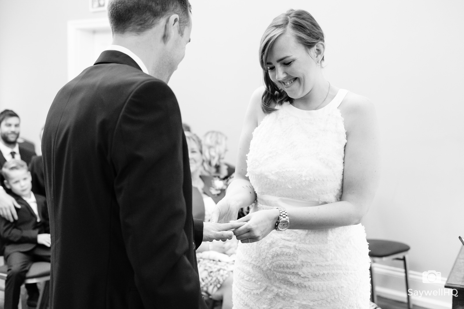 west bridgford wedding photography - bride and groom exchange rings during the wedding ceremony