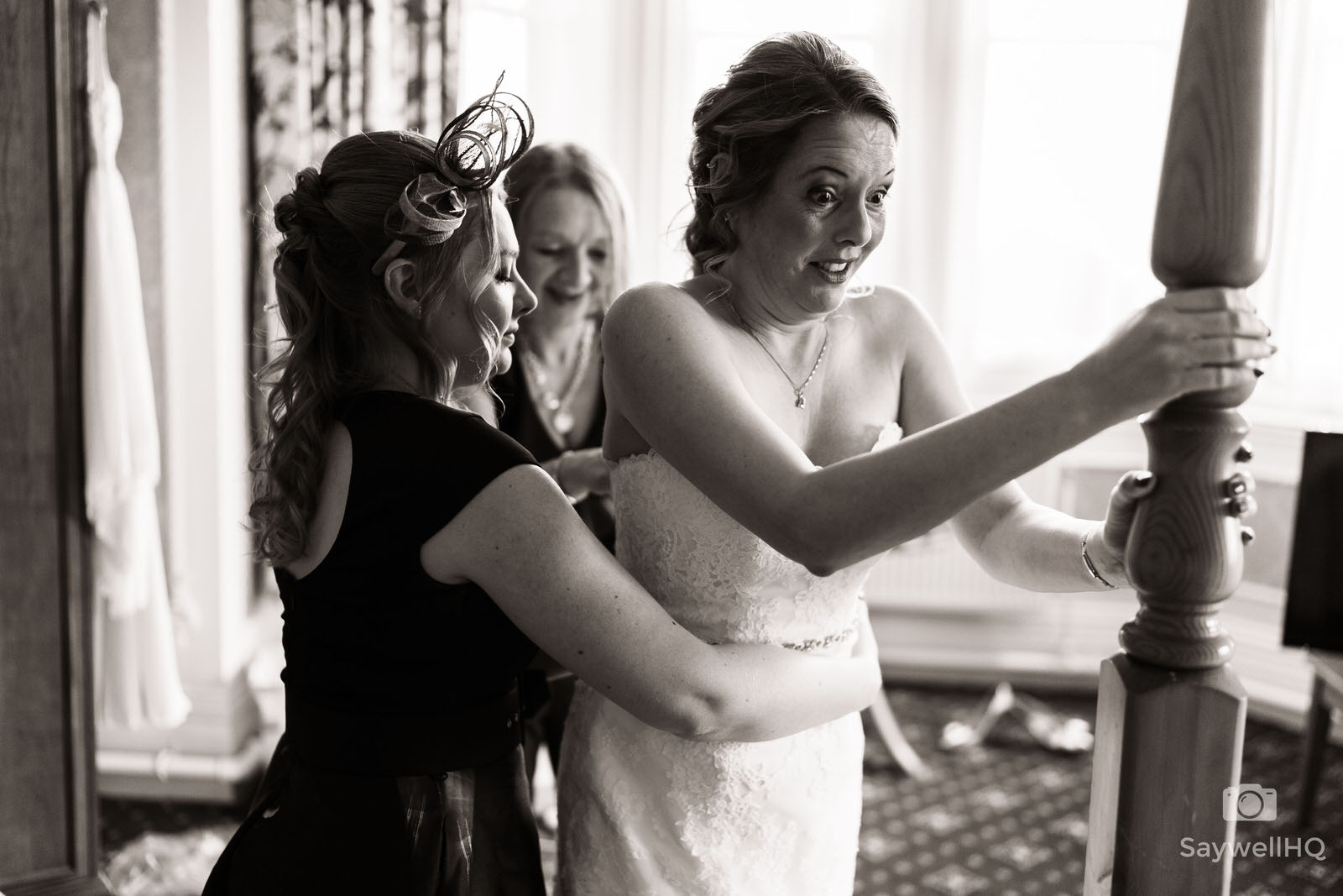 Bestwood Lodge Wedding Photography bride having help getting into her wedding dress