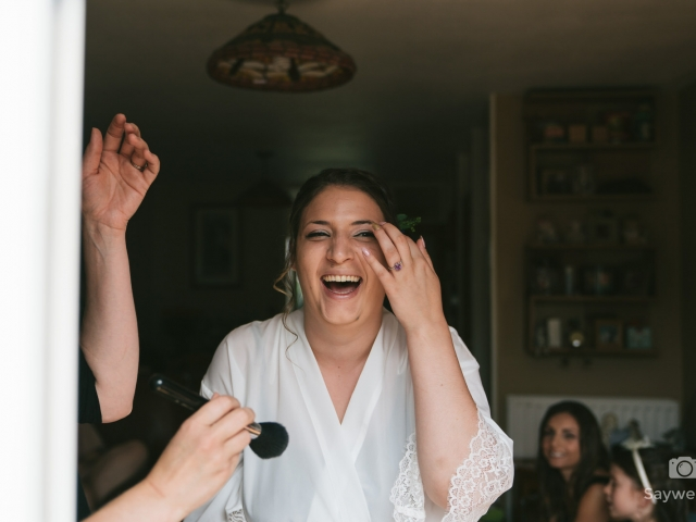 Swancar Farm Wedding Photography bride laughing in window light
