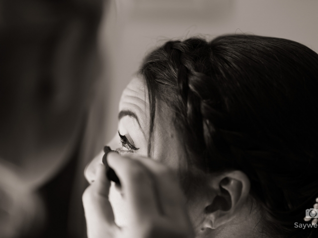 Swancar Farm Wedding Photography closeup of the bride getting her hair lashes done