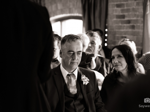 Swancar Farm Wedding Photography grooms dad looking down listening to the wedding vows