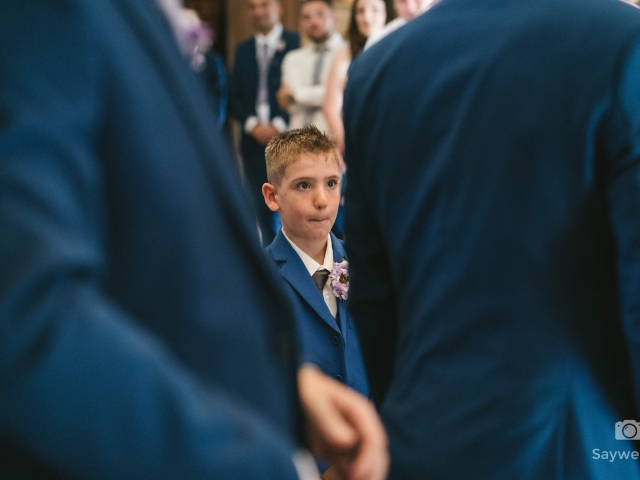 Swancar Farm Wedding Photography page boy handing over the wedding rings