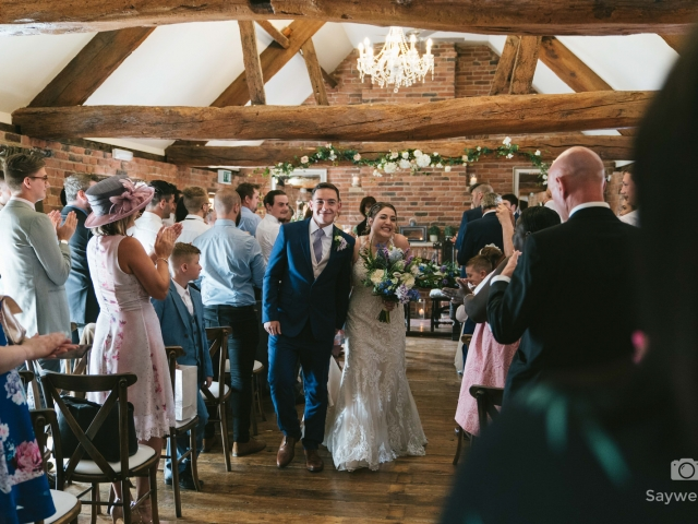 Swancar Farm Wedding Photography bride and groom walking down the aisle as a married couple hand in hand