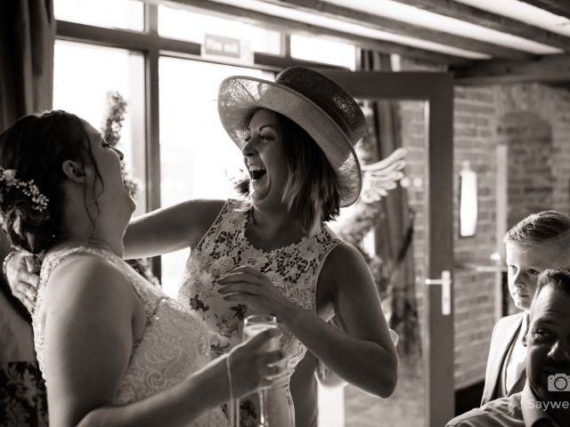 Swancar Farm Wedding Photography bride and guest enjoy a joke after the wedding ceremony