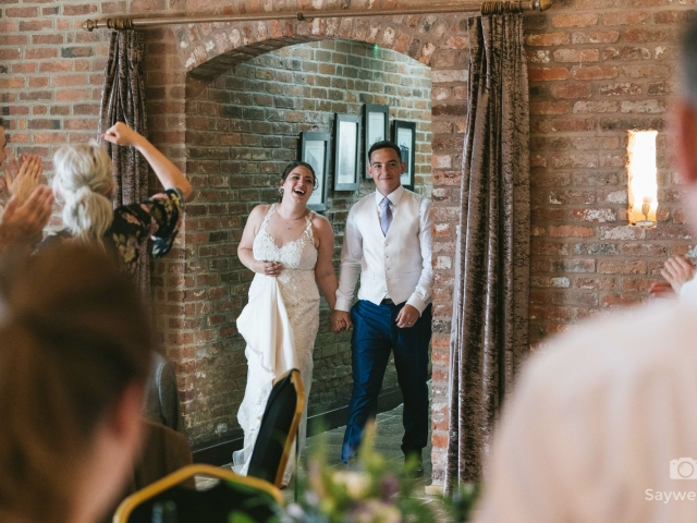 Swancar Farm Wedding Photography bride and groom announced into the wedding breakfast