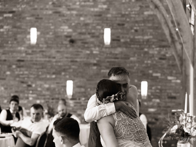 Swancar Farm Wedding Photography bride and grooms dad enjoy a hug after the wedding speeches