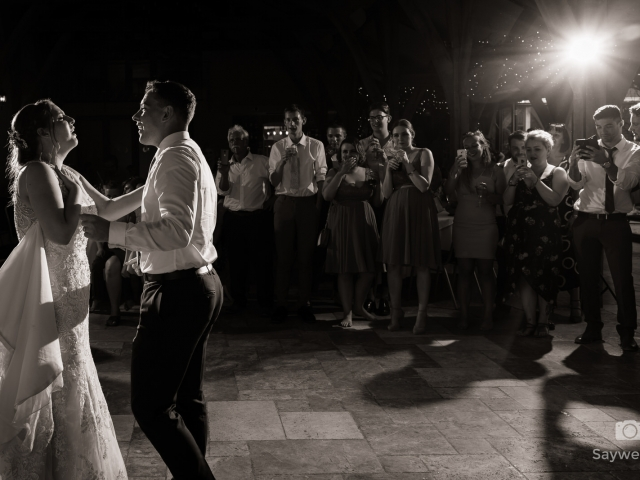 Swancar Farm Wedding Photography bride and groom sing to each other during the first dance