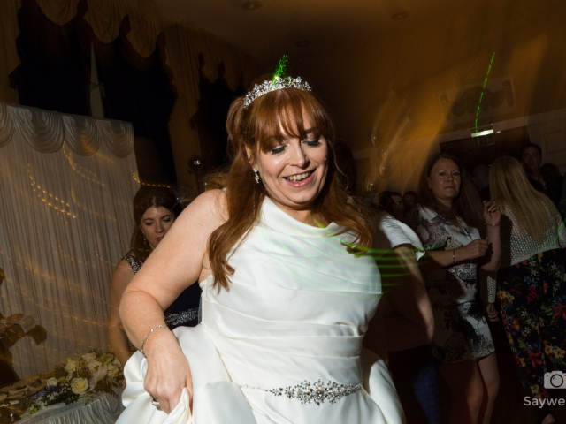 wedding photography at Bestwood Lodge Hotel - bride dancing on the dancefloor