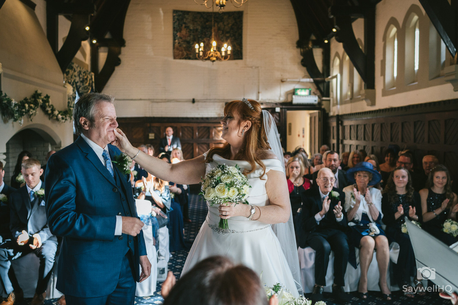 Bestwood Lodge wedding photography bride rubbing lipstick off the groom