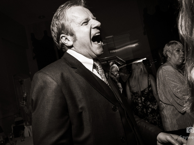 wedding photography at Bestwood Lodge Hotel - groom laughing on the dancefloor