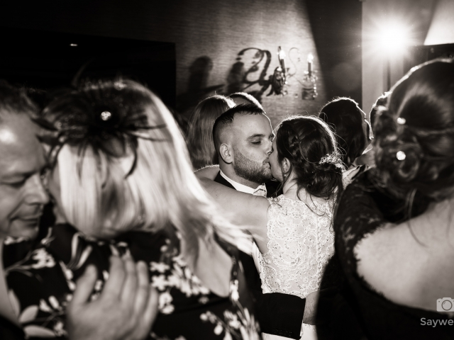 Wedding photography at Goosedale - bride and groom kiss during the first dance