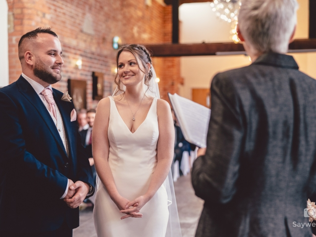 Wedding photography at Goosedale - bride and groom looking at each other during the wedding ceremony