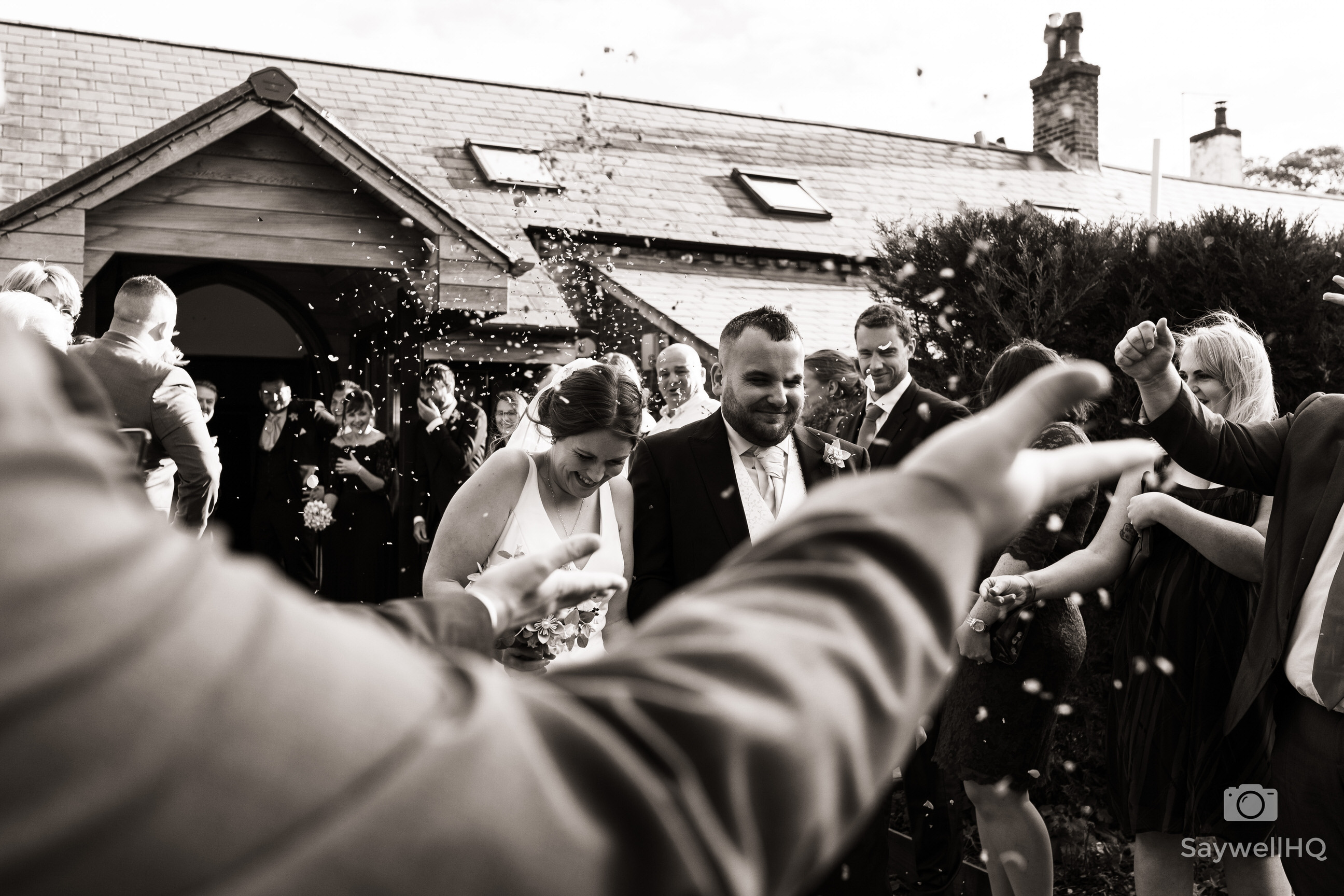 Goosedale wedding photography - bride and Groom get covered in confetti after the wedding ceremony