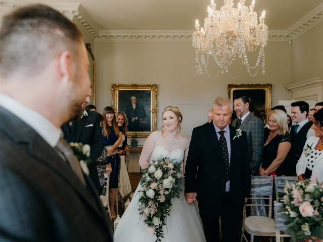 Wedding Photography at Norwood Park bride looking all excited when walking down the aisle with her father
