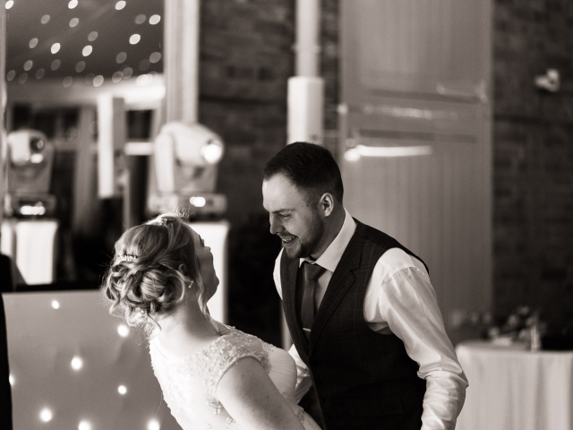 Wedding Photography at Norwood Park - bride and groom on the dancefloor leaning into each other