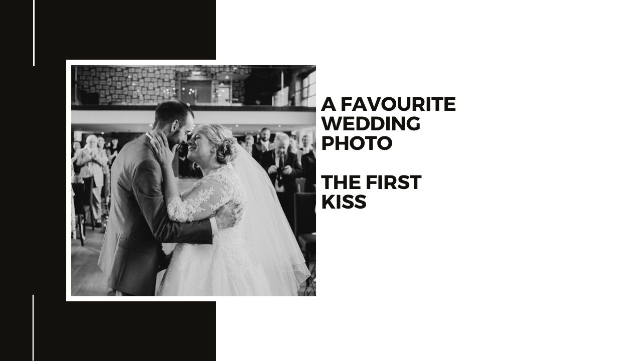Wedding photography at The Carriage Hall - Bride and Groom first Kiss