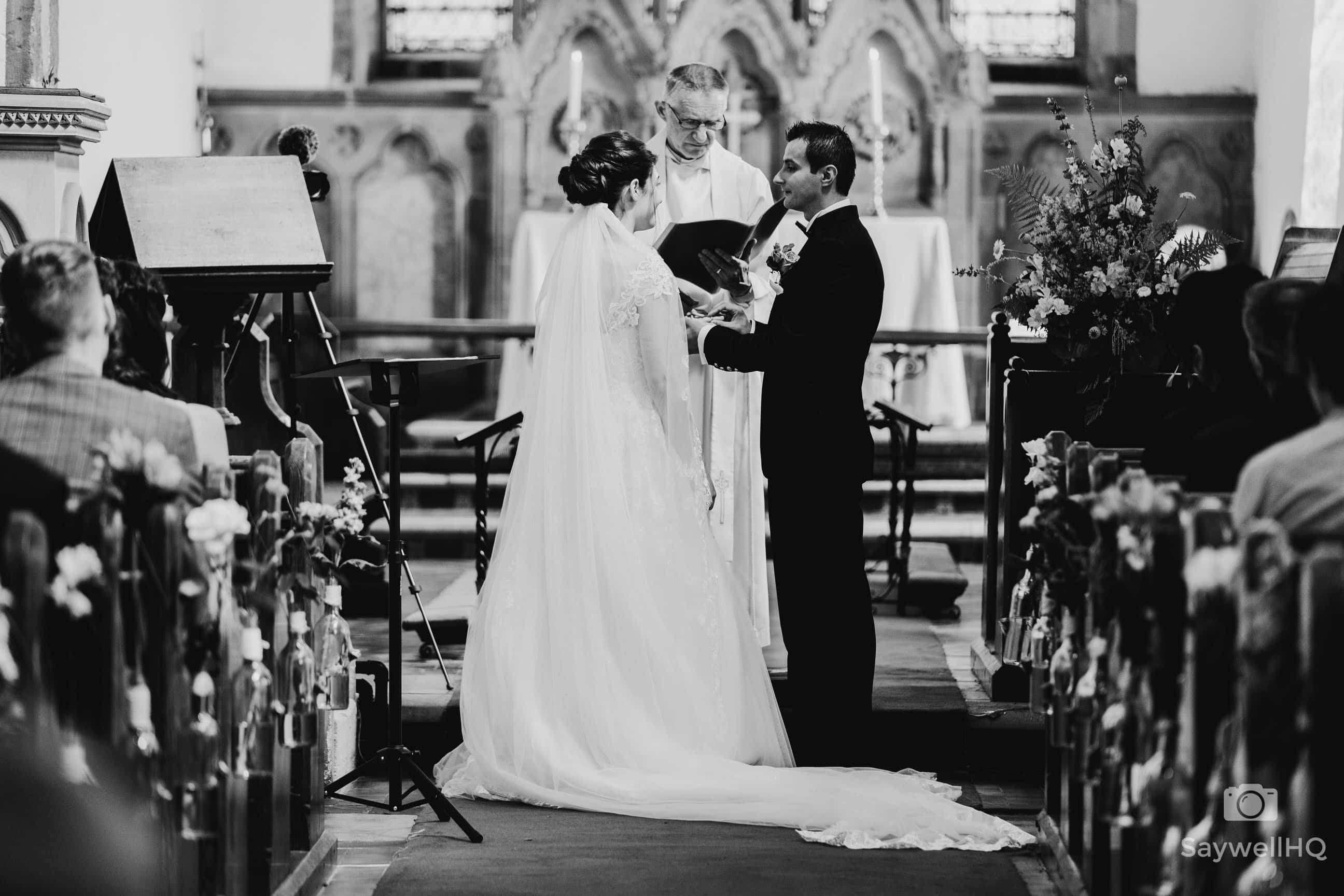 Nottingham Church Wedding Photographer - bride and groom exchange rings