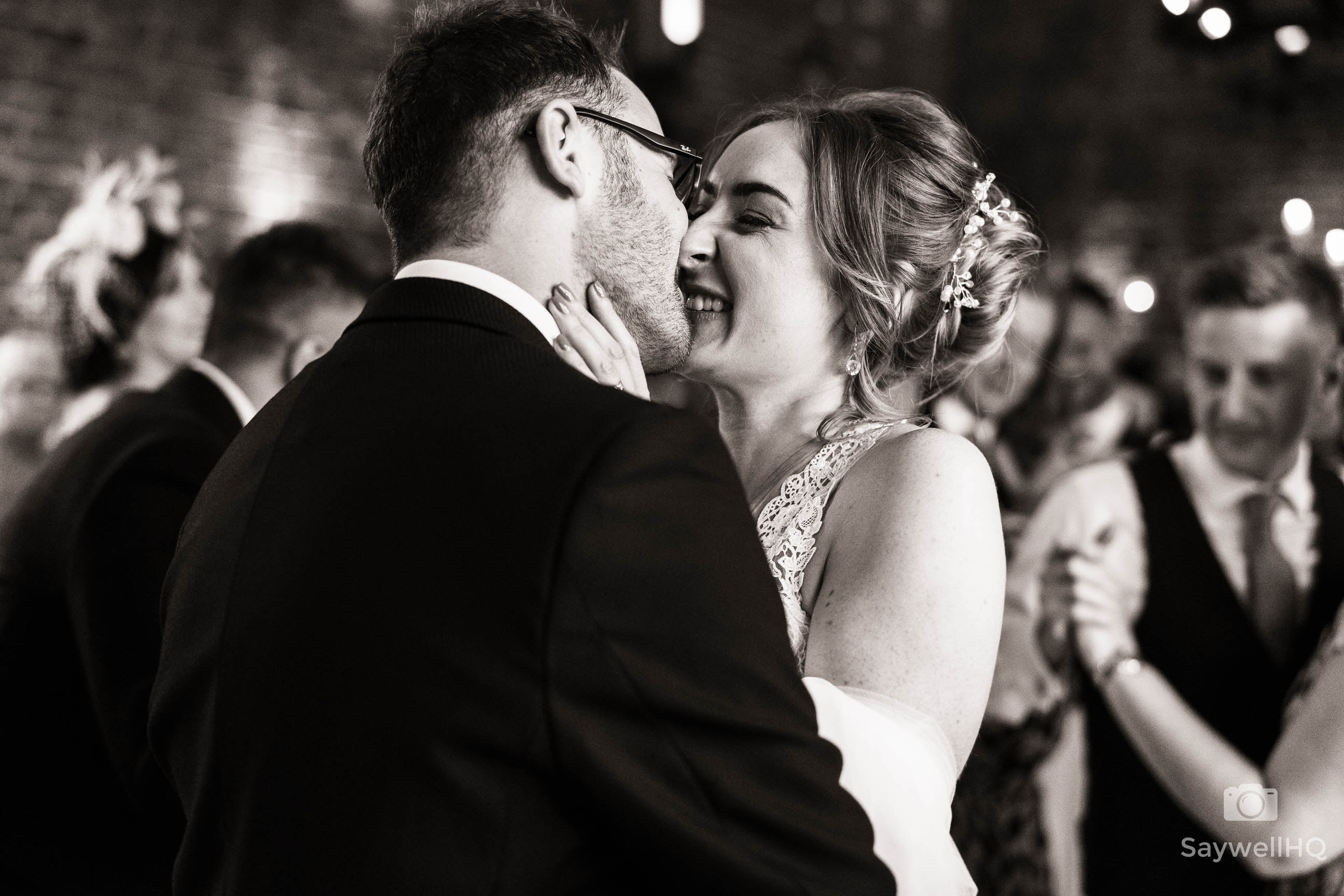 bride and groom kissing after the first dance at Hazel Gap Barns