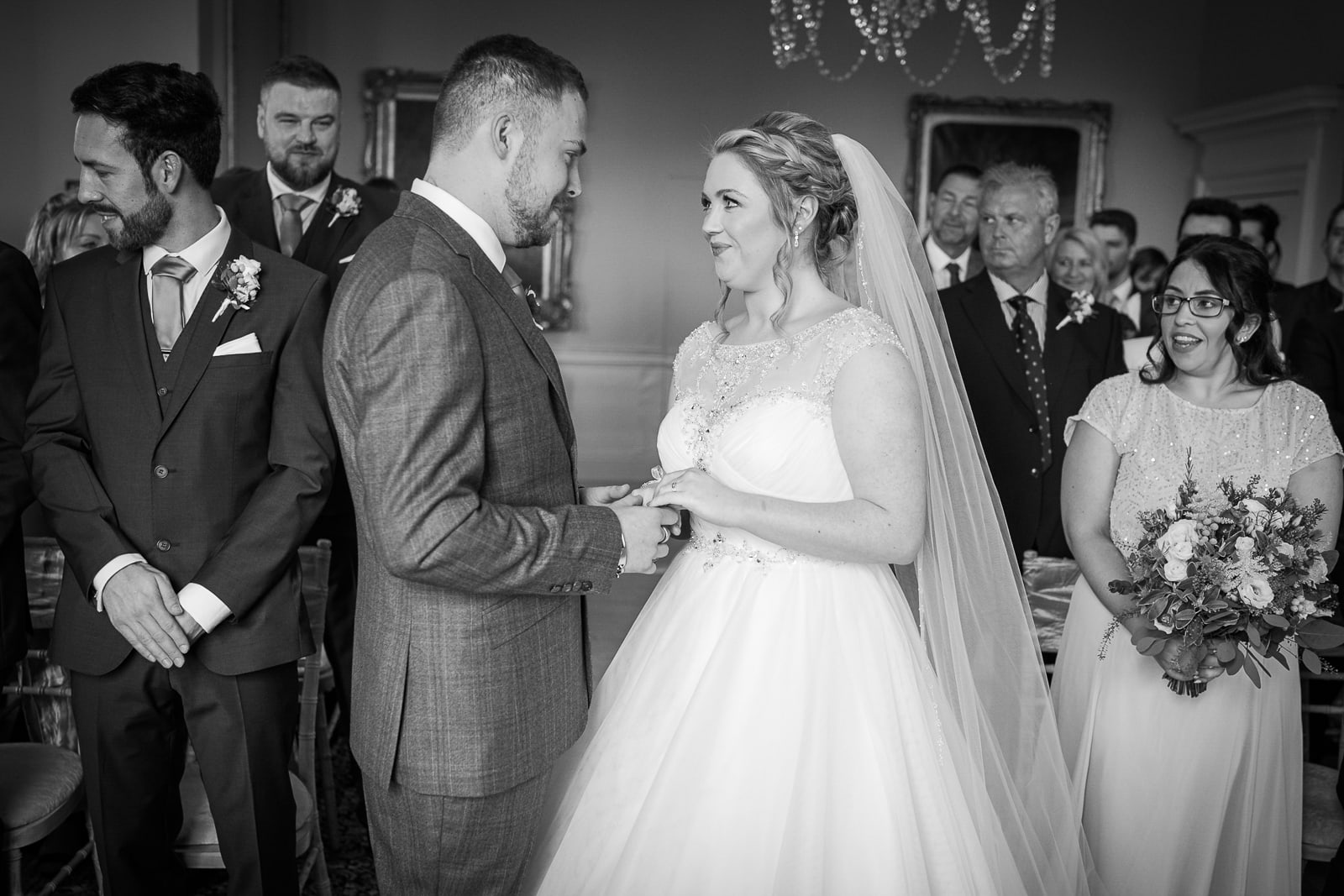 Norwood Park Wedding Photography - Bride and Groom exchanging rings during the wedding ceremony