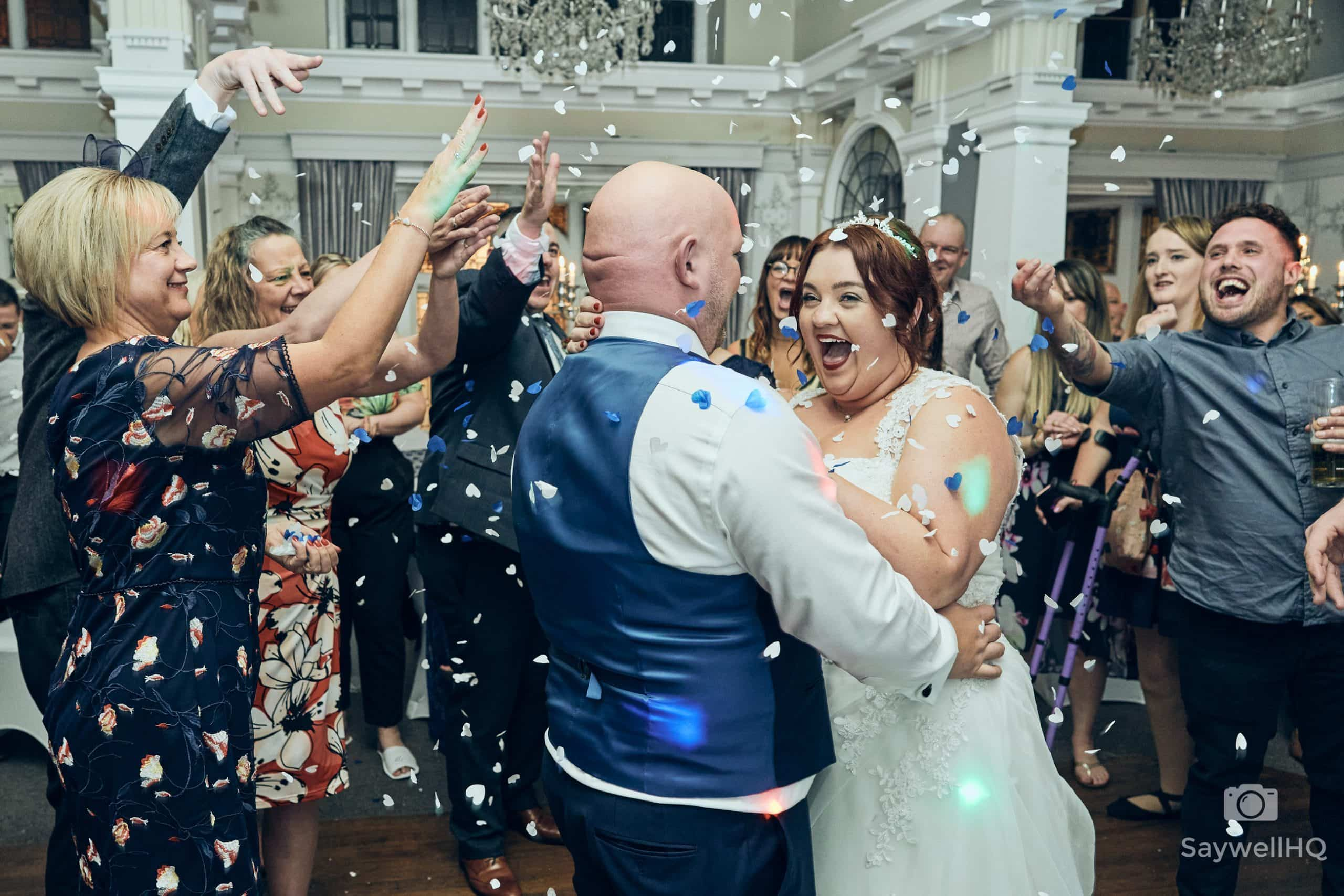 The Embankment Nottingham Wedding Photography - bride and groom showered in confetti during the first dance at the embankment pub in Nottingham