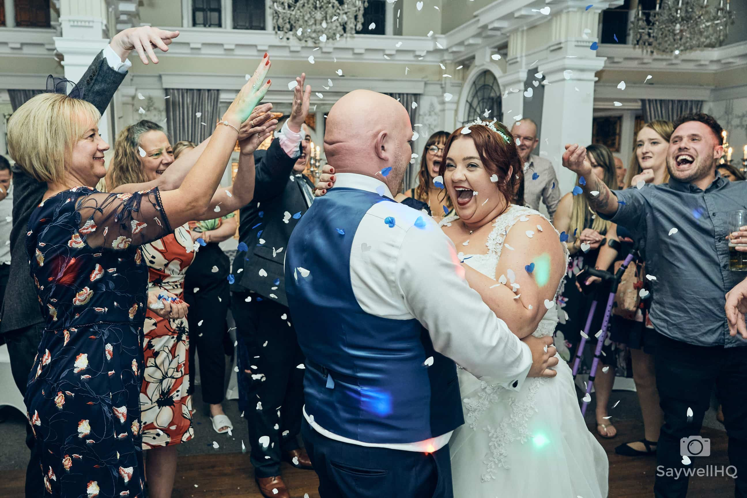 The Embankment Pub Wedding Photography - bride and groom showered in confetti during the first dance at the embankment pub in Nottingham