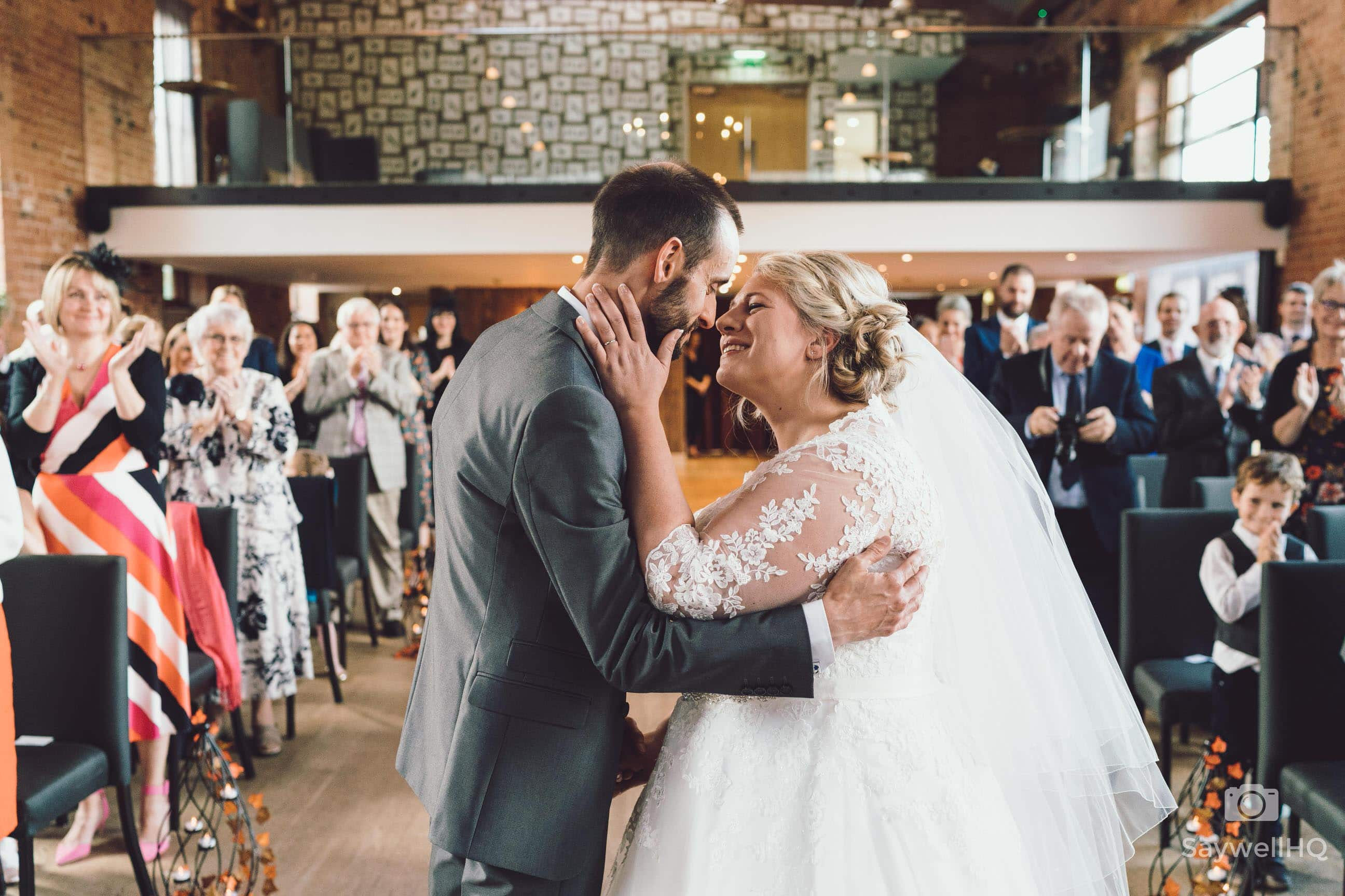Wedding photography at The Carriage Hall in Nottingham + Bride and groom first kiss