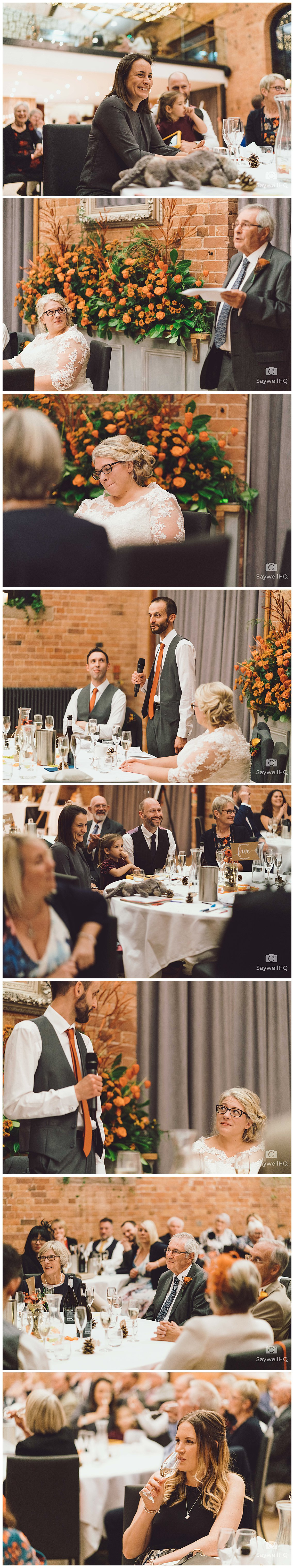Wedding photography at Carriage Hall in Nottingham - bride and groom enjoy the speeches at their wedding at carriage hall