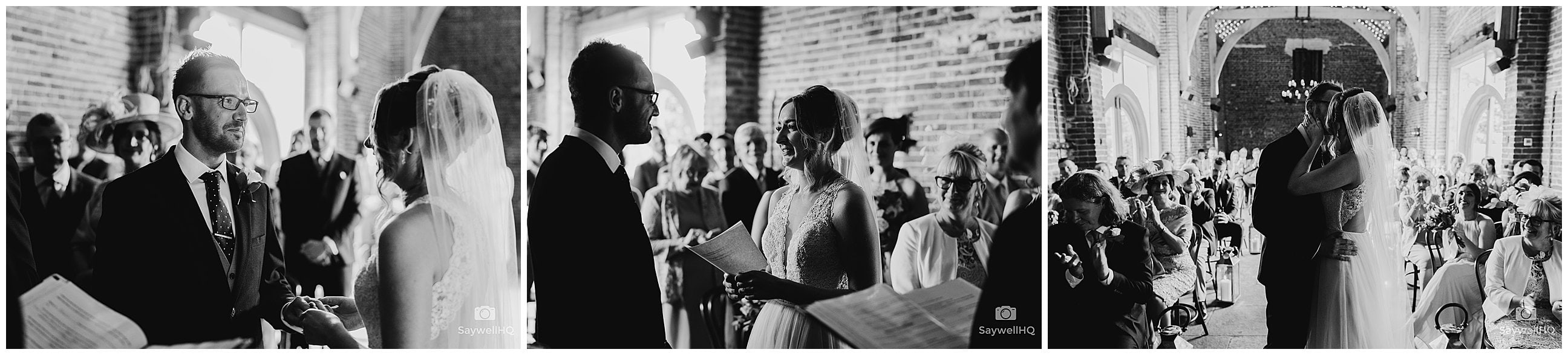 Wedding Photography at Hazel Gap Barn – bride and groom look lovinly at each other during the wedding ceremony at hazel gap barns