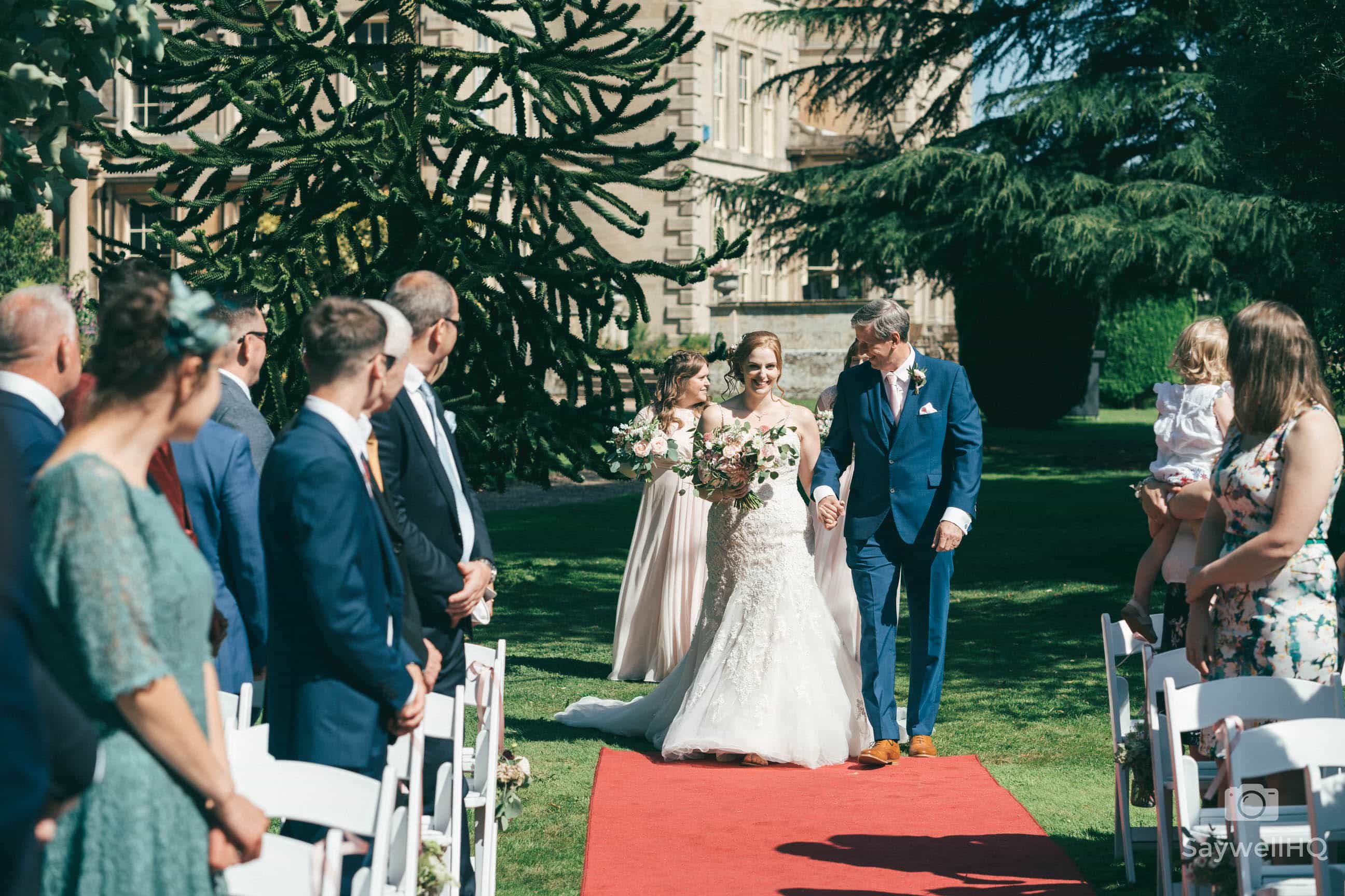 Wedding Photography at Prestwold Hall – bride and her dad walking down the aisle at prestwold hall wedding photography