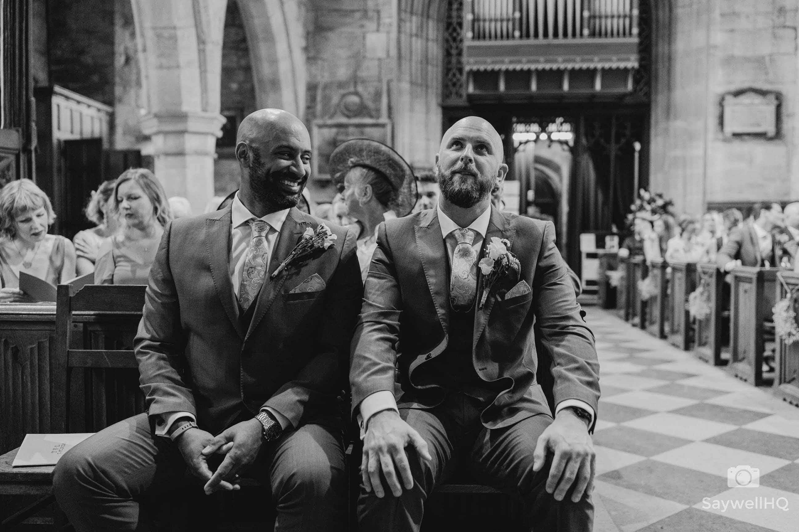 Derby Wedding Photography at St Bartholomew's Church - groom looking nervous at his church wedding