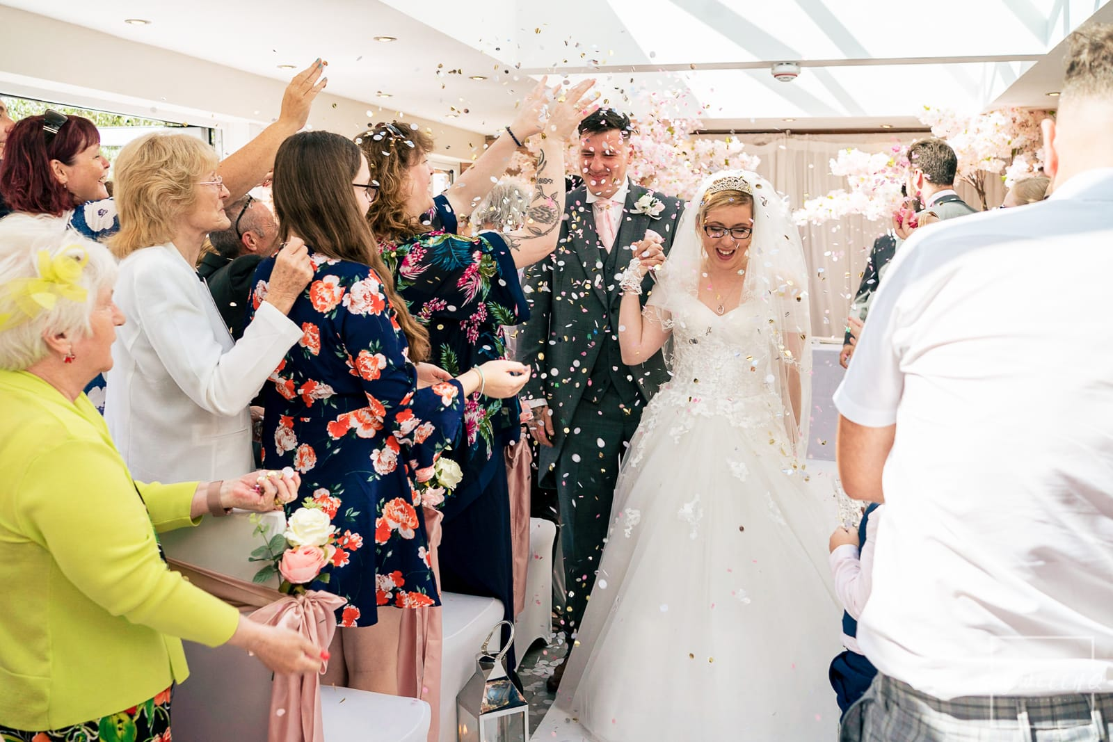White Hart Inn at Moorwood Moor Wedding Photography - bride and groom walking through confetti at their wedding at the White Hart Inn Alfreton