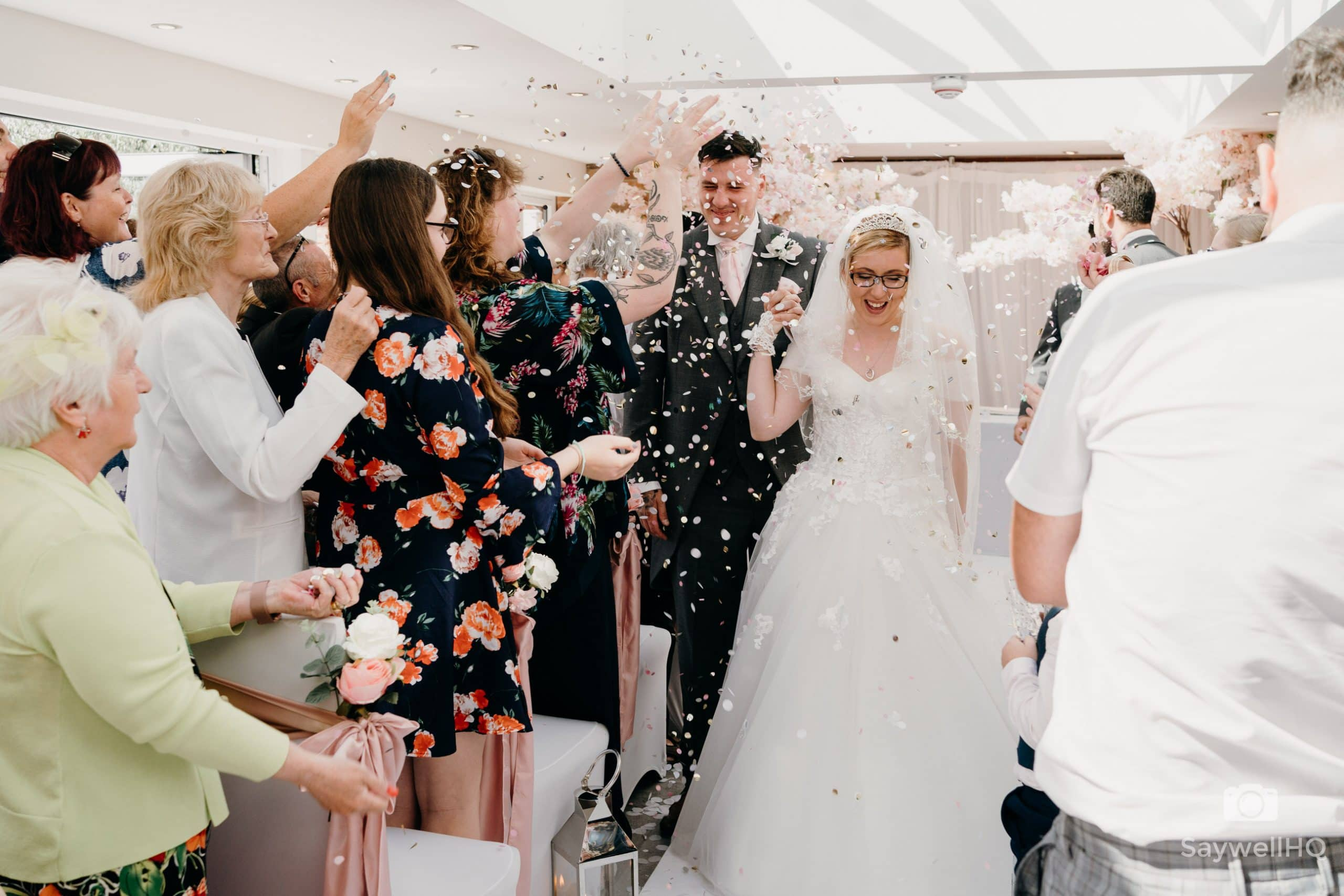 THE WHITE HART AT MOORWOOD MOOR Wedding Photography Documentary Wedding Photographer - bride and groom walking through the confetti!