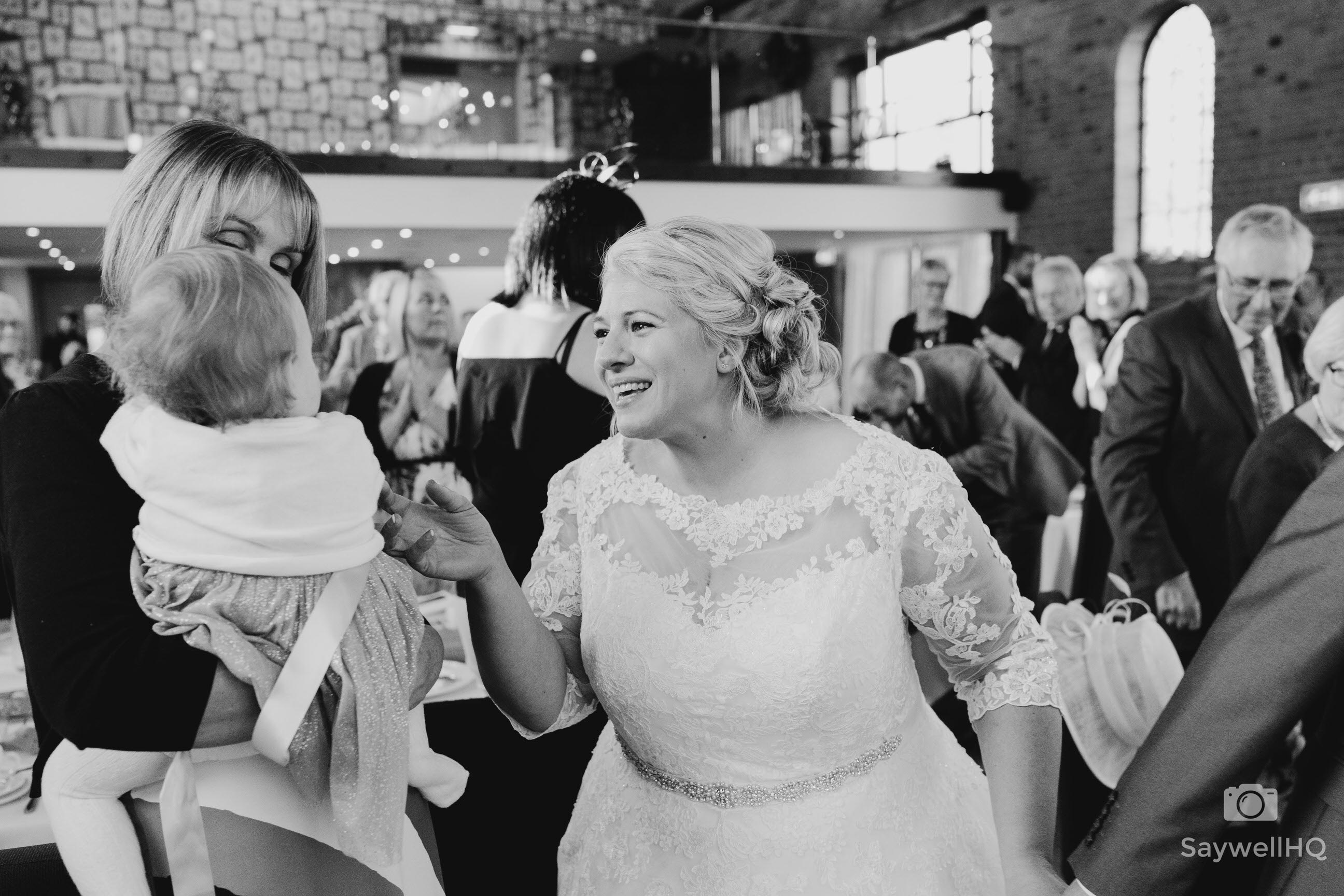 Wedding photography at Carriage Hall in Nottingham + bride and daughter have an emotional moment at a wedding at the Carriage Hall Plumtree