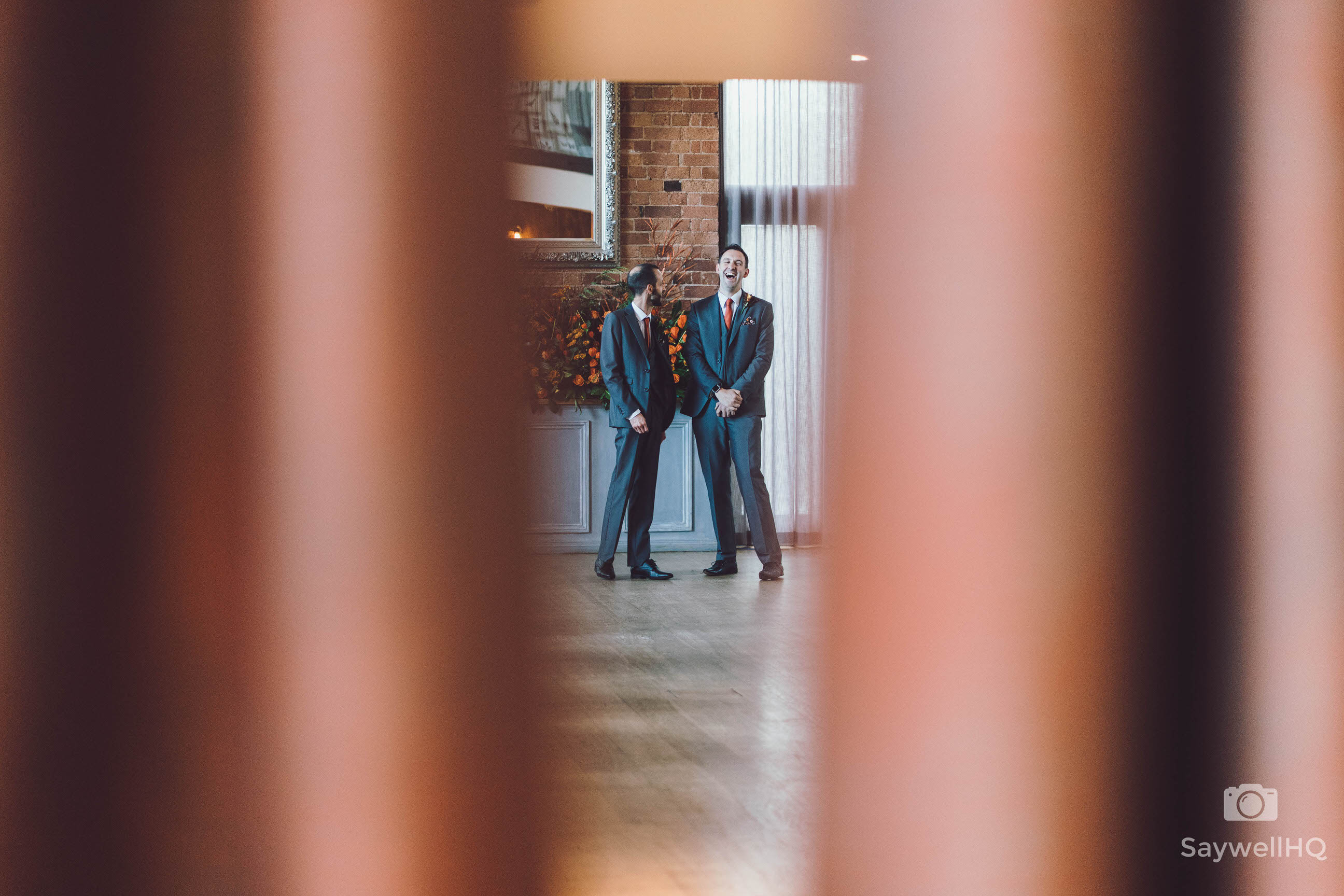 Wedding photography at Carriage Hall in Nottingham + best mand and groom laugh during the wedding ceremony