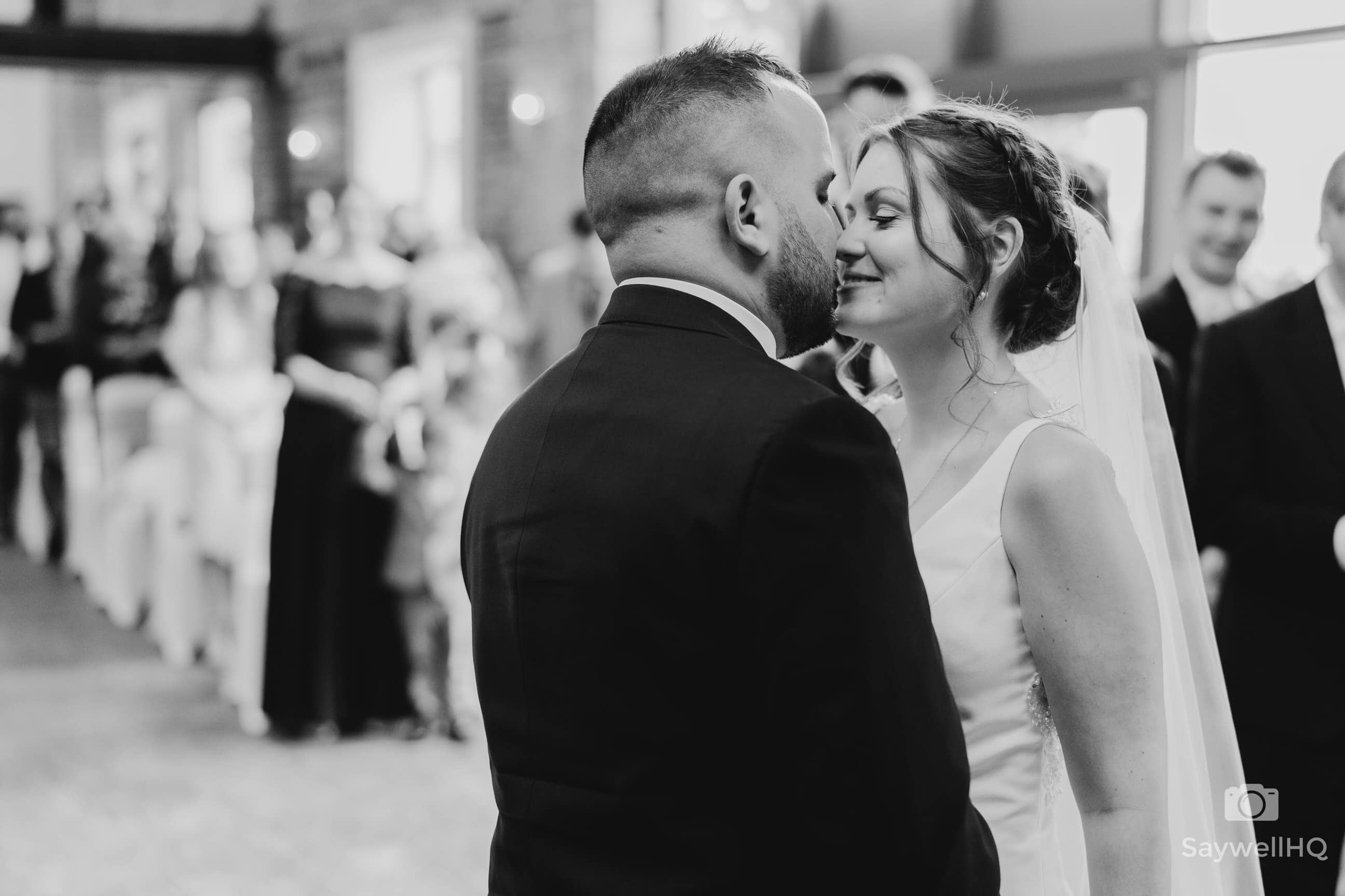 Wedding Photography at Goosedale - bride and groom first kiss in black and white