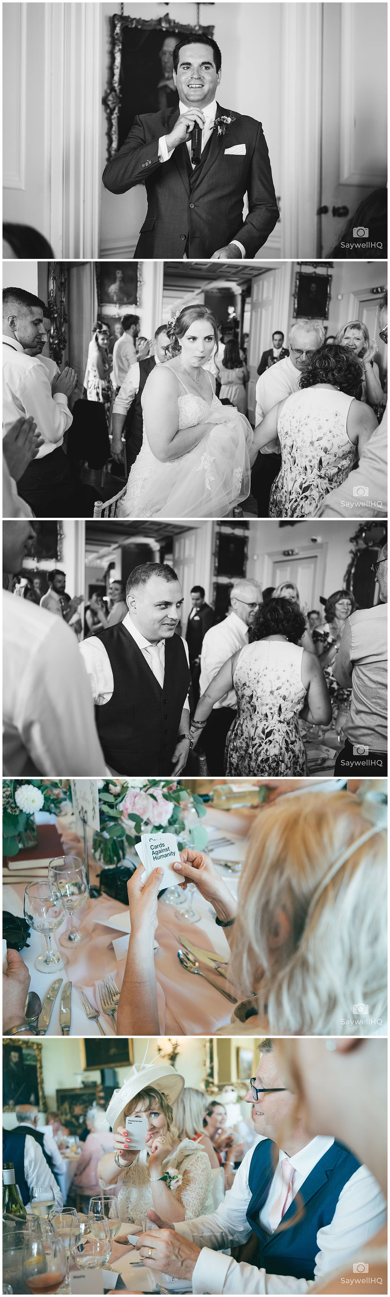 Wedding Photography at Prestwold Hall – guests play cards against humanity during the wedding breakfast at prestwold hall