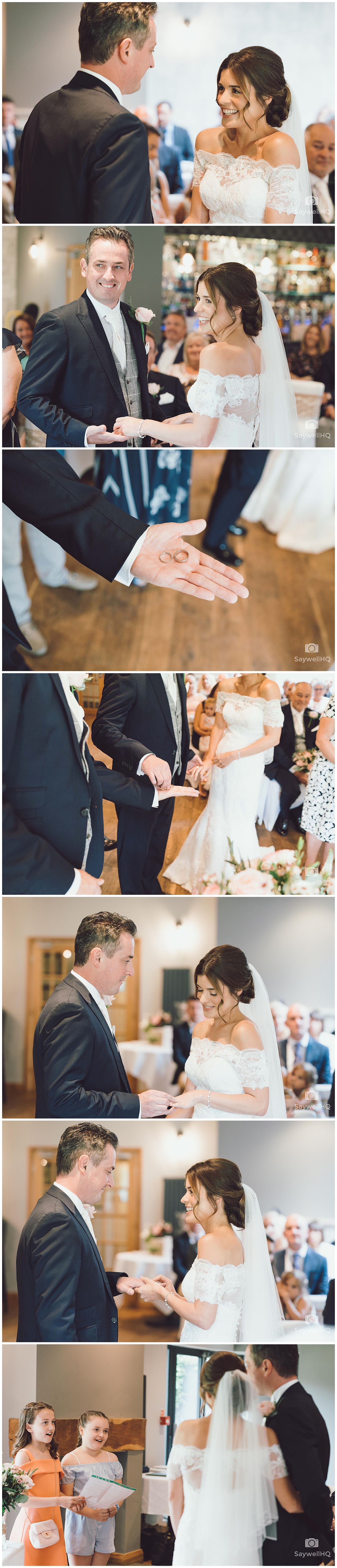 The Chequers Inn Woolsthorpe Wedding Photography - bride and groom kiss and sign the wedding register