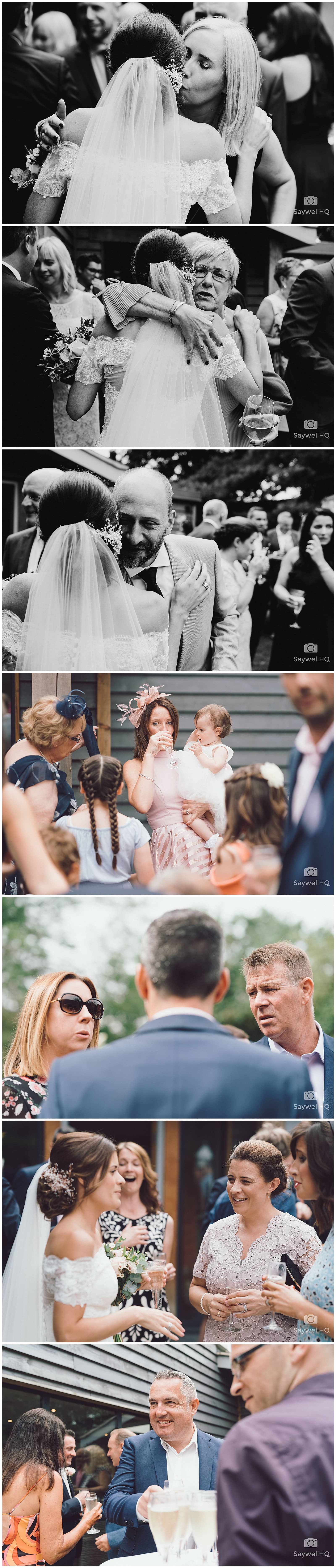 The Chequers Inn Woolsthorpe Wedding Photography - wedding guests chat and talk in the pub garden